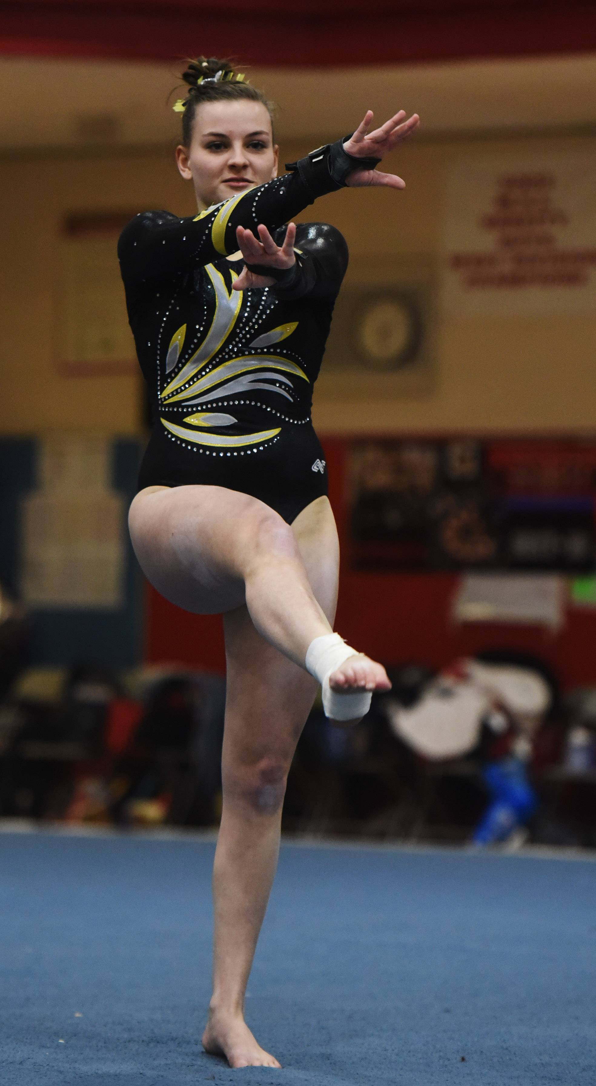 Molly Meehan of Jacobs competes on the floor exercise during the Palatine regional Wednesday.
