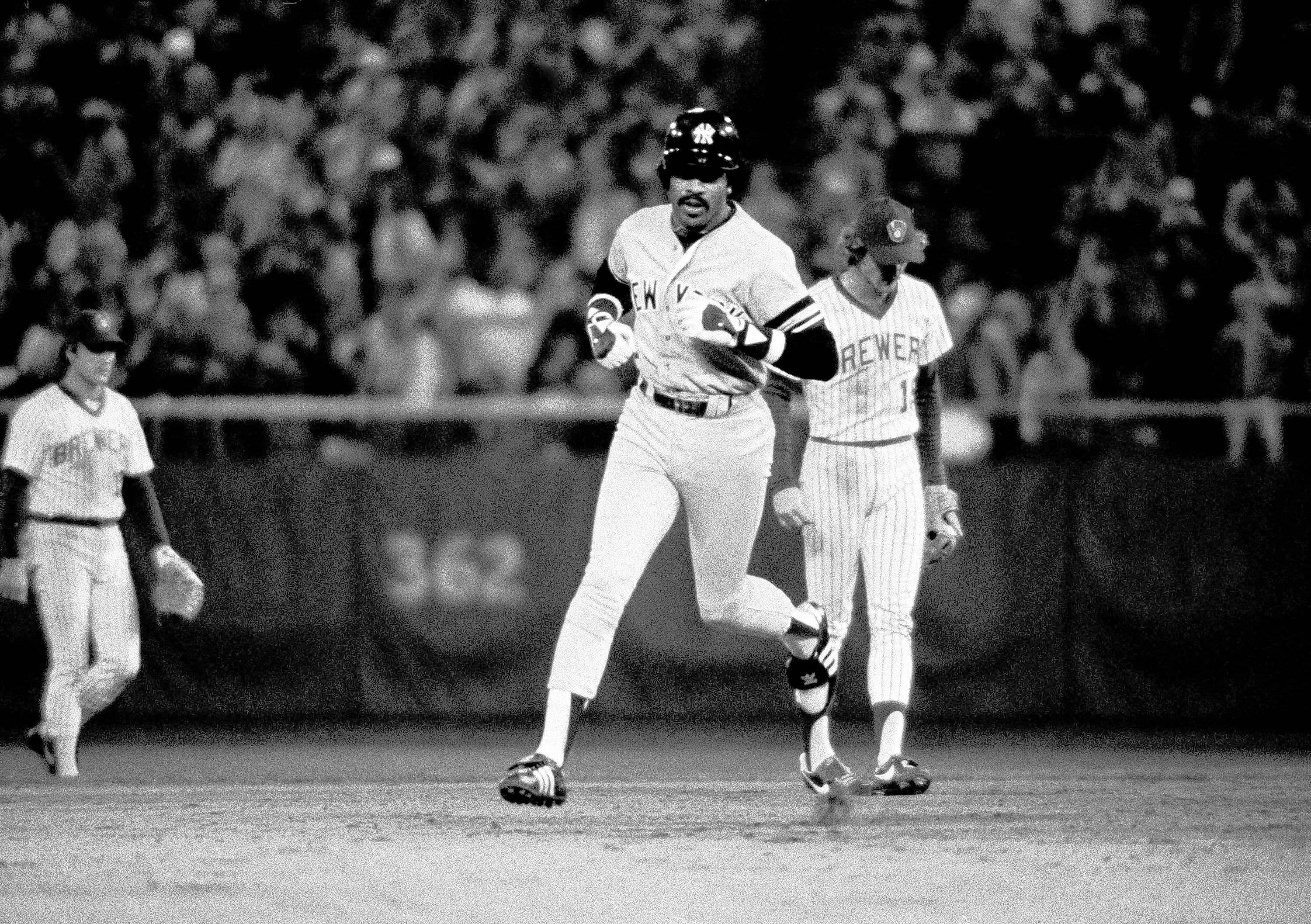 New York Yankee designated hitter Oscar Gamble rounds the bases past Milwaukee's Robin Yount after hitting a two-run homer in Milwaukee. Gamble, who hit 31 home runs for the White Sox in 1977, died Wednesday at age 68.