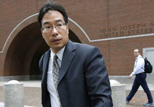FILE - In this Sept. 19, 2017, file photo, Glenn Chin, supervisory pharmacist at the now-closed New England Compounding Center, leaves federal court in Boston. Chin, a Massachusetts pharmacist charged in a deadly 2012 meningitis outbreak, was cleared in October of second-degree murder charges, but convicted on dozens of other counts. He is scheduled to be sentenced on Wednesday, Jan. 31, 2018.