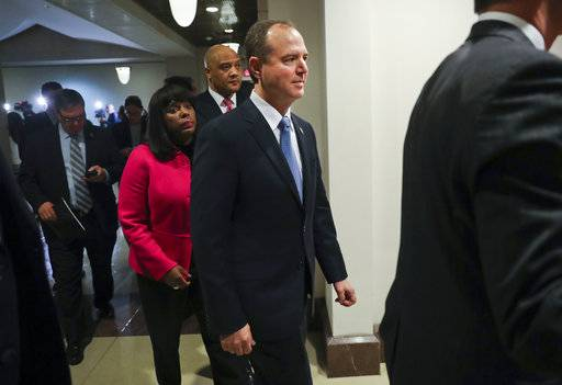 Rep. Adam Schiff, D- Calif., center, ranking member of the House Intelligence Committee, walks back to the meeting room after speaking to members of the media, Monday, Jan. 29, 2018 on Capitol Hill in Washington. Also with Schiff are Rep. Terri Sewell, D-Ala., left, and Rep. Andre Carson, D-Ind. Brushing aside opposition from the Department of Justice, Republicans on the House intelligence committee have voted to release a classified memo that purports to show improper use of surveillance by the FBI and Justice Department in the Russia investigation.