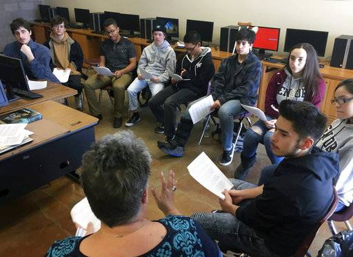 In this Jan. 18, 2018, photo, english and college-preparation teacher Rhonda Gardner, bottom, leads a discussion about how to adjust to the academic, financial and social pressures of collegiate life for high school seniors at the Academy for Technology and the Classics in Santa Fe, N.M.