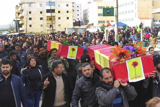 FILE -- In this Jan. 22, 2018 file photo, Kurdish mourners carry the coffins of people who were killed by Turkish shelling and airstrikes, during their funeral procession, in the Kurdish enclave of Afrin, Syria. Syria's Kurdish militia is growing frustrated with its patron, the United States, and is pressing it to do more to stop Turkey's assault on Afrin. Their complaints reflect the differing agendas. The Kurds want to ensure their self-rule, while the U.S. wants them to focus on governing the territory they wrested from IS militants. (Sipam Jan/Rohani via AP, File)