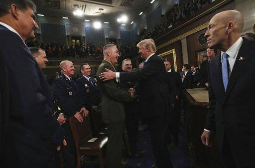 President Donald Trump greets Chairman of the Joint Chiefs of Staff Gen. Joseph Dunford after delivering his first State of the Union address in the House chamber of the U.S. Capitol to a joint session of Congress Tuesday, Jan. 30, 2018 in Washington. (Win McNamee/Pool via AP)