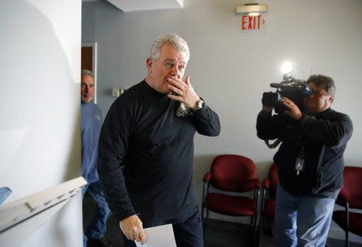 U.S. Rep. Bob Brady of Philadelphia, walk away after holding a news conference Wednesday, Jan. 31, 2018, in Philadelphia. Brady, a plainspoken former carpenter and cheerleader for the city, will not seek another term in Congress, giving up the seat he's held for two decades, his office said Wednesday.