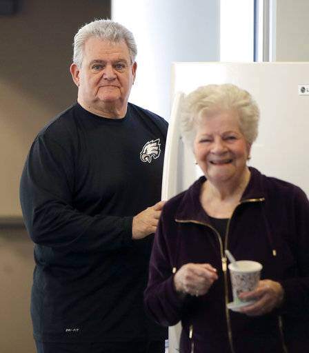 U.S. Rep. Bob Brady of Philadelphia, left, is seen with an unidentified person, at the Philadelphia Democratic City Committee Wednesday, Jan. 31, 2018, in Philadelphia. Brady will not seek another term in Congress, giving up the seat he's held for two decades, his office said Wednesday.