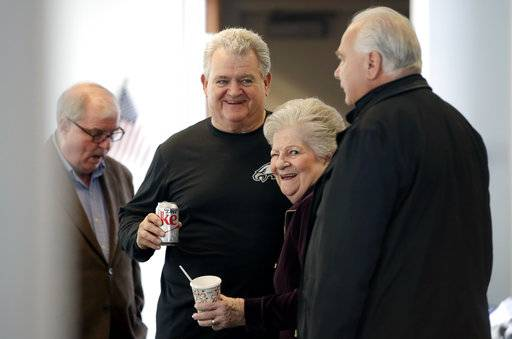 U.S. Rep. Bob Brady of Philadelphia, center, smiles as he talks to unidentified people, at the Philadelphia Democratic City Committee Wednesday, Jan. 31, 2018, in Philadelphia. Brady will not seek another term in Congress, giving up the seat he's held for two decades, his office said Wednesday.