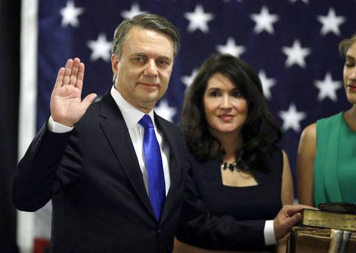 Republican Jeff Colyer is sworn in as the 47th Governor of Kansas during a ceremony at the Statehouse in Topeka, Kan., Wednesday, Jan. 31, 2018. Colyer, the state's longest-serving lieutenant governor, replaced former GOP Gov. Sam Brownback immediately after Brownback stepped down to become U.S. ambassador-at-large for international religious freedom.