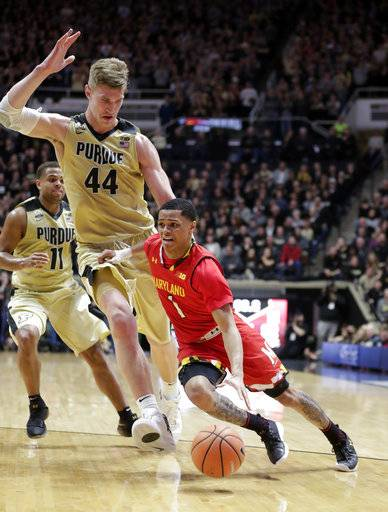 Maryland guard Anthony Cowan (1) drives past Purdue center Isaac Haas (44) during the first half of an NCAA college basketball game in West Lafayette, Ind., Wednesday, Jan. 31, 2018.
