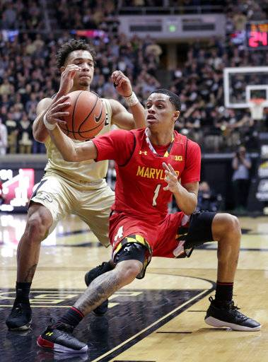 Maryland guard Anthony Cowan (1) tries to fake Purdue guard Carsen Edwards (3) as he drives during the first half of an NCAA college basketball game in West Lafayette, Ind., Wednesday, Jan. 31, 2018.