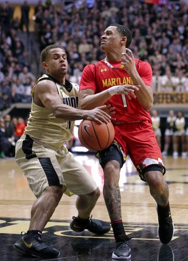 Purdue guard P.J. Thompson (11) steals the ball from Maryland guard Anthony Cowan (1) during the first half of an NCAA college basketball game in West Lafayette, Ind., Wednesday, Jan. 31, 2018.