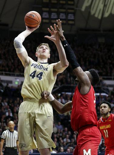 Purdue center Isaac Haas (44) shoots over Maryland forward Bruno Fernando (23) during the second half of an NCAA college basketball game in West Lafayette, Ind., Wednesday, Jan. 31, 2018. Purdue defeated Maryland 75-67.