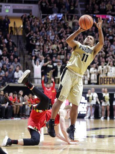 Purdue guard P.J. Thompson (11) shoots after being fouled by Maryland guard Kevin Huerter (4) during the second half of an NCAA college basketball game in West Lafayette, Ind., Wednesday, Jan. 31, 2018. Purdue defeated Maryland 75-67.
