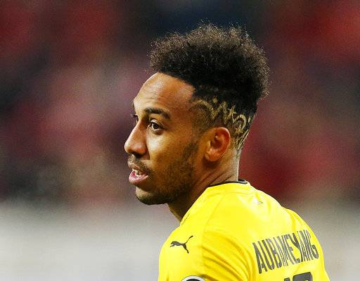 FILE - In this Dec. 12, 2017 file photo Dortmund's Pierre-Emerick Aubameyang looks on during a German first division Bundesliga soccer match between FSV Mainz 05 and Borussia Dortmund in Mainz, Germany.