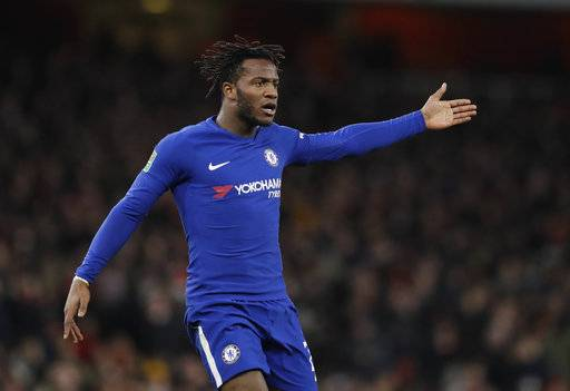 FILE - In this Wednesday, Jan.24, 2018 file photo, Chelsea's Michy Batshuayi gestures during the English League Cup semifinal second leg soccer match between Chelsea and Arsenal at the Emirates stadium in London. Michy Batshuayi has joined Borussia Dortmund on loan from Chelsea until the end of the season. The Belgium striker's move completes a triangle of transfers that saw Arsenal sign Pierre-Emerick Aubameyang from Dortmund and sell Olivier Giroud to Chelsea earlier on Wednesday, Jan. 31, 2018.