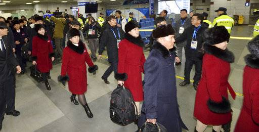 A North Korean delegation and athletes arrive at Yangyang International Airport in Yangyang, South Korea, Thursday, Feb. 1, 2018. North Korean skiers and skaters on Thursday arrived at a South Korean airport to participate in the Winter Olympics that has brought a temporary lull in tensions surrounding their country's nuclear program. (Korea Pool/Yonhap via AP)