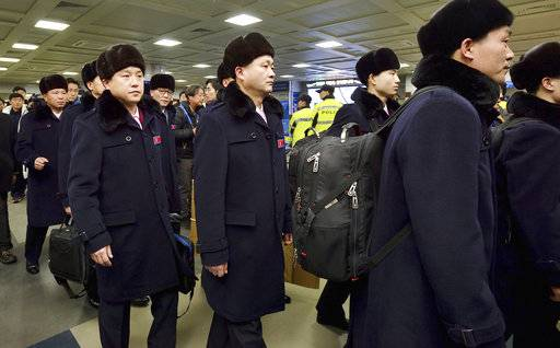 A North Korean delegation and athletes arrive at the Yangyang International Airport in Yangyang, South Korea, Thursday, Feb. 1, 2018. North Korean skiers and skaters on Thursday arrived at a South Korean airport to participate in the Winter Olympics that has brought a temporary lull in tensions surrounding their country's nuclear program. (Korea Pool/Yonhap via AP)