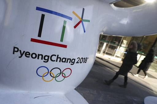 The official emblem of the 2018 Pyeongchang Games is seen in downtown Seoul, South Korea, Thursday, Feb. 1, 2018. In a rare sight, North Korean flags flew in South Korea on Thursday as the South prepared for the Winter Olympics that has brought a temporary lull in tensions surrounding the North's nuclear program.