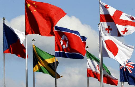 The North Korean flag, center, flies amongst flags from many nations as they fly at the Olympic Village at the 2018 Winter Olympics in Gangneung, South Korea, Thursday, Feb. 1, 2018.