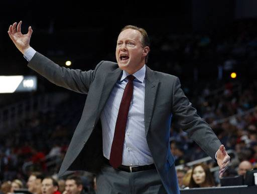 Atlanta Hawks coach Mike Budenholzer argues with an official during the first half of the team's NBA basketball game against the Charlotte Hornets on Wednesday, Jan. 31, 2018, in Atlanta.