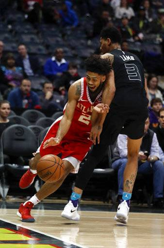 Atlanta Hawks guard Tyler Dorsey (2) drives against Charlotte Hornets guard Jeremy Lamb during the first half of an NBA basketball game Wednesday, Jan. 31, 2018, in Atlanta.
