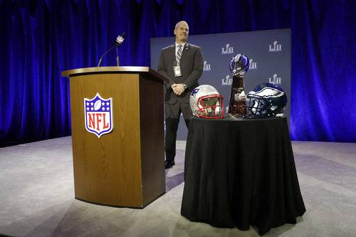Security specialist James Contreras watches over the Vince Lombardi Trophy before a news conference by Commissioner Roger Goodell in advance of the Super Bowl 52 football game, Wednesday, Jan. 31, 2018, in Minneapolis. The Philadelphia Eagles play the New England Patriots on Sunday, Feb. 4, 2018.