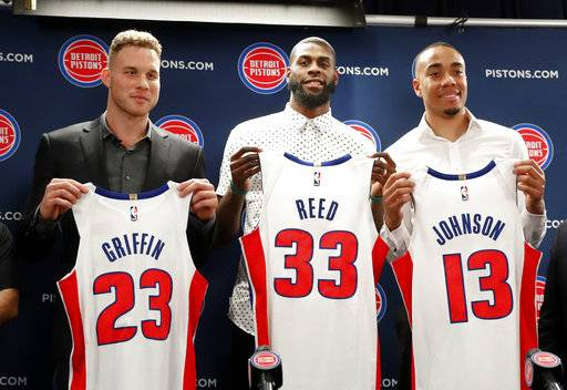 Detroit Pistons' Blake Griffin, from left, Willie Reed and Brice Johnson pose with their new NBA basketball uniforms in Auburn Hills, Mich., Wednesday, Jan. 31, 2018.