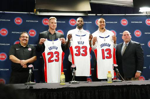 Detroit Pistons head coach Stan Van Gundy, from left, Blake Griffin, Willie Reed, Brice Johnson and General Manager Jeff Bower pose with their new NBA basketball uniforms in Auburn Hills, Mich., Wednesday, Jan. 31, 2018.