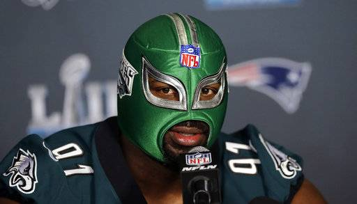Philadelphia Eagles defensive tackle Fletcher Cox wears a wrestling mask as he takes part in a media availability for the NFL Super Bowl 52 football game Wednesday, Jan. 31, 2018, in Minneapolis. Philadelphia is scheduled to face the New England Patriots Sunday.