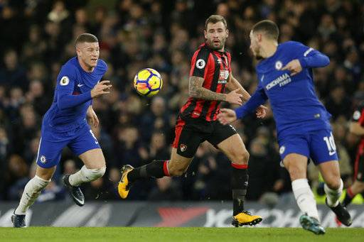 Chelsea's Ross Barkley, left, chases the ball as Chelsea's Eden Hazard, right, and Bournemouth's Steve Cook look on during the English Premier League soccer match between Chelsea and Bournemouth at Stamford Bridge in London, Wednesday Jan. 31, 2018.