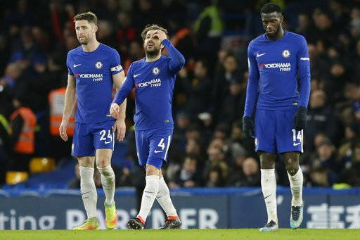 Chelsea's Cesc Fabregas, centre, Gary Cahill, left, and Tiemoue Bakayoko look dejected after Bournemouth's third goal during the English Premier League soccer match between Chelsea and Bournemouth at Stamford Bridge in London, Wednesday Jan. 31, 2018.
