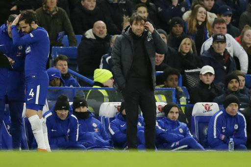 Chelsea manager Antonio Conte, right, looks dejected after Bournemouth's second goal as Chelsea's Cesc Fabregas, left, waits the be substituted during the English Premier League soccer match between Chelsea and Bournemouth at Stamford Bridge in London, Wednesday Jan. 31, 2018.