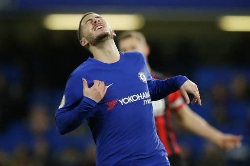 Chelsea's Eden Hazard looks dejected during the English Premier League soccer match between Chelsea and Bournemouth at Stamford Bridge in London, Wednesday Jan. 31, 2018.