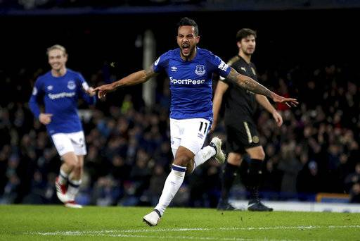 Everton's Theo Walcott celebrates scoring his side's first goal of the game during their English Premier League soccer match against Leicester City at Goodison Park, Liverpool, England, Wednesday, Jan. 31, 2018. (Nick Potts/PA via AP)