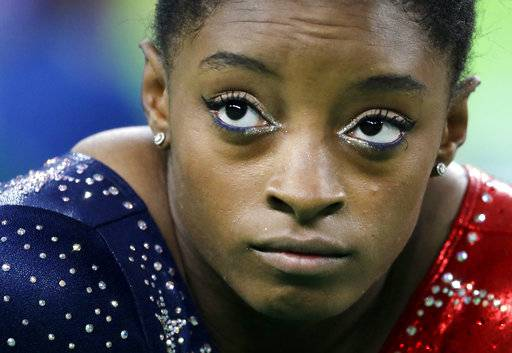 FILE - In this Aug. 7, 2016, file photo, United States' Simone Biles waits to perform her floor routine during the artistic gymnastics women's qualification at the 2016 Summer Olympics in Rio de Janeiro, Brazil. Sunday. Biles has met the new president of USA Gymnastics but hasn't heard from the U.S. Olympic Committee regarding the Larry Nassar sexual abuse scandal. The four-time gold medalist at the Rio Games is training for the 2020 Tokyo Olympics.