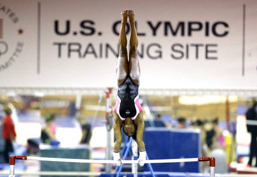 FILE - In this Sept. 12, 2015, file photo, U.S. gymnast Simone Biles trains at the Karolyi Ranch in New Waverly, Texas. Biles has met the new president of USA Gymnastics but hasn't heard from the U.S. Olympic Committee regarding the Larry Nassar sexual abuse scandal. The four-time gold medalist at the Rio Games is training for the 2020 Tokyo Olympics.