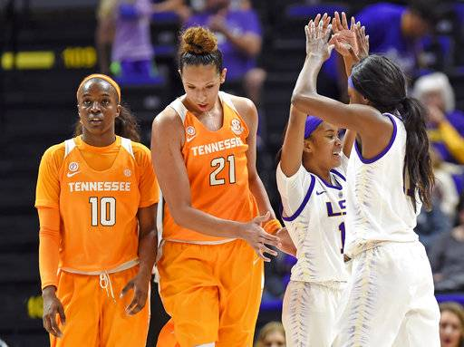 LSU guard Jaelyn Richard-Harris (13) celebrates with guard Raigyne Louis (11) as Tennessee guard Meme Jackson (10) and center Mercedes Russell (21) walk by in the closing moments of the fourth quarter of an NCAA college basketball game, Sunday, Jan. 28, 2018, in Baton Rouge, La.