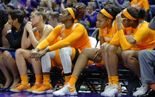 From left to right, Tennessee players Kortney Dunbar, Cheridene Green, Kasiyahna Kushkituah and Kamera Harris watch the closing moments of the fourth quarter of an NCAA college basketball game, Sunday, Jan. 28, 2018, in Baton Rouge, La.