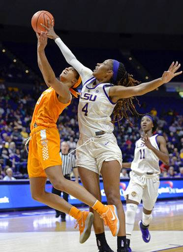 LSU forward Raven Farley (4) gets a hand on the ball to block the shot of Tennessee guard Jaime Nared (31) as teammate LSU guard Raigyne Louis (11) watches in the 4th quarter of an NCAA college basketball game, Sunday, Jan. 28, 2018, in Baton Rouge, La. LSU won 70-59.