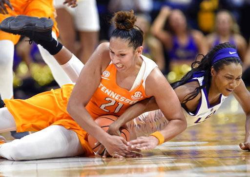 Tennessee center Mercedes Russell (21) dives on the floor to recover the ball she knocked loose from LSU guard Chloe Jackson (0) who also dives in during the fourth quarter of an NCAA college basketball game, Sunday, Jan. 28, 2018, in Baton Rouge, La.
