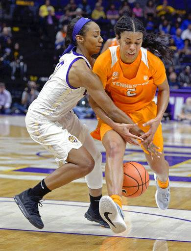 LSU guard Chloe Jackson (0) knocks the ball loose from Tennessee guard Evina Westbrook (2) for a turnover in the fourth quarter of an NCAA college basketball game, Sunday, Jan. 28, 2018, in Baton Rouge, La.