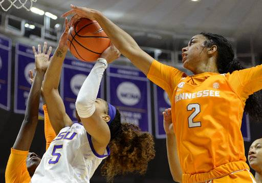 Tennessee guard Evina Westbrook (2) blocks a shot by LSU forward Ayana Mitchell (5) in the first half of an NCAA college basketball game, Sunday, Jan. 28, 2018, in Baton Rouge, La.
