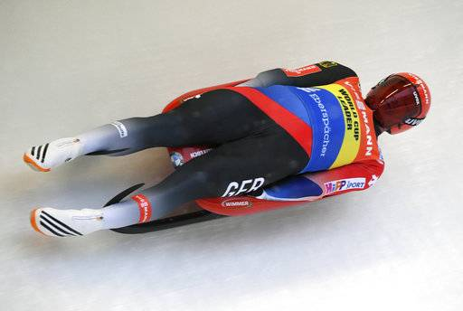 FILE - In this Jan. 28, 2018, file photo, Germany's Felix Loch speeds down the track during a men's race at the Luge World Cup event in Sigulda, Latvia. German greats Natalie Geisenberger and Felix Loch are the reigning Olympic gold medalists, and the favorites to win more gold in luge at the Pyeongchang Games.