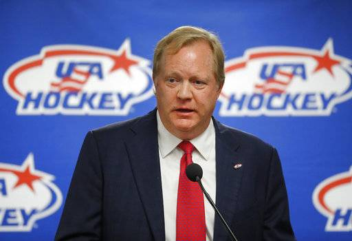 FILE - This Aug. 4, 2017 file photo shows Jim Johannson speaking during a news conference in Plymouth, Mich. Johannson, the general manager of the U.S. Olympic men's hockey team, has died just a couple weeks before the start of the Pyeongchang Games, Sunday, Jan. 21, 2018. He was 53.