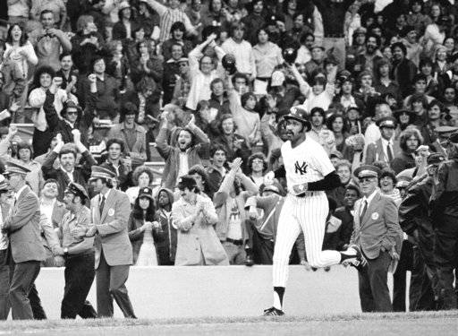 FILE - In this June 6, 1976, file photo, New York Yankees' Oscar Gamble heads for home plate after hitting a ninth inning home run to beat the Oakland A's 5-2 in the second baseball game of a doubleheader at Yankee Stadium in New York. Gamble, an outfielder who hit 200 home runs over 17 major league seasons, died Wednesday, Jan. 31, 2018, of a rare tumor of the jaw. He was 68.