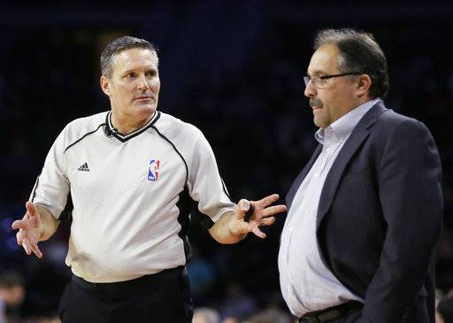 In this Feb. 21, 2016, photo, referee Monty McCutchen talks with Detroit Pistons head coach Stan Van Gundy during the first half of an NBA basketball game against the New Orleans Pelicans in Auburn Hills, Mich. McCutchen is now working in the league office and is tasked with trying to get referees and players to get along better.