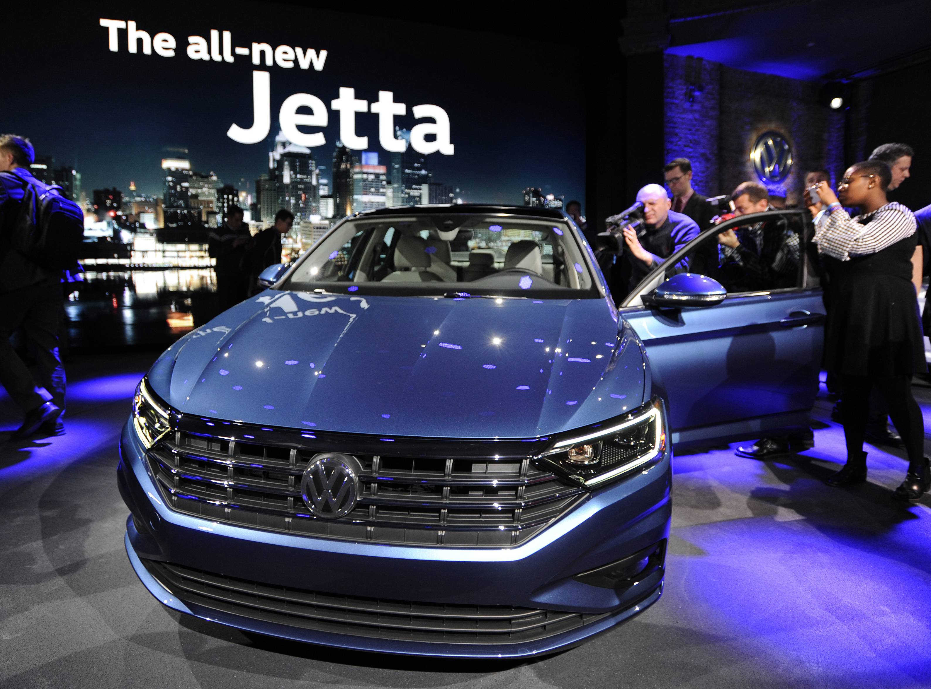 Following a news conference, members of the media photograph the 2019 Volkswagen Jetta at the North American International Auto Show.