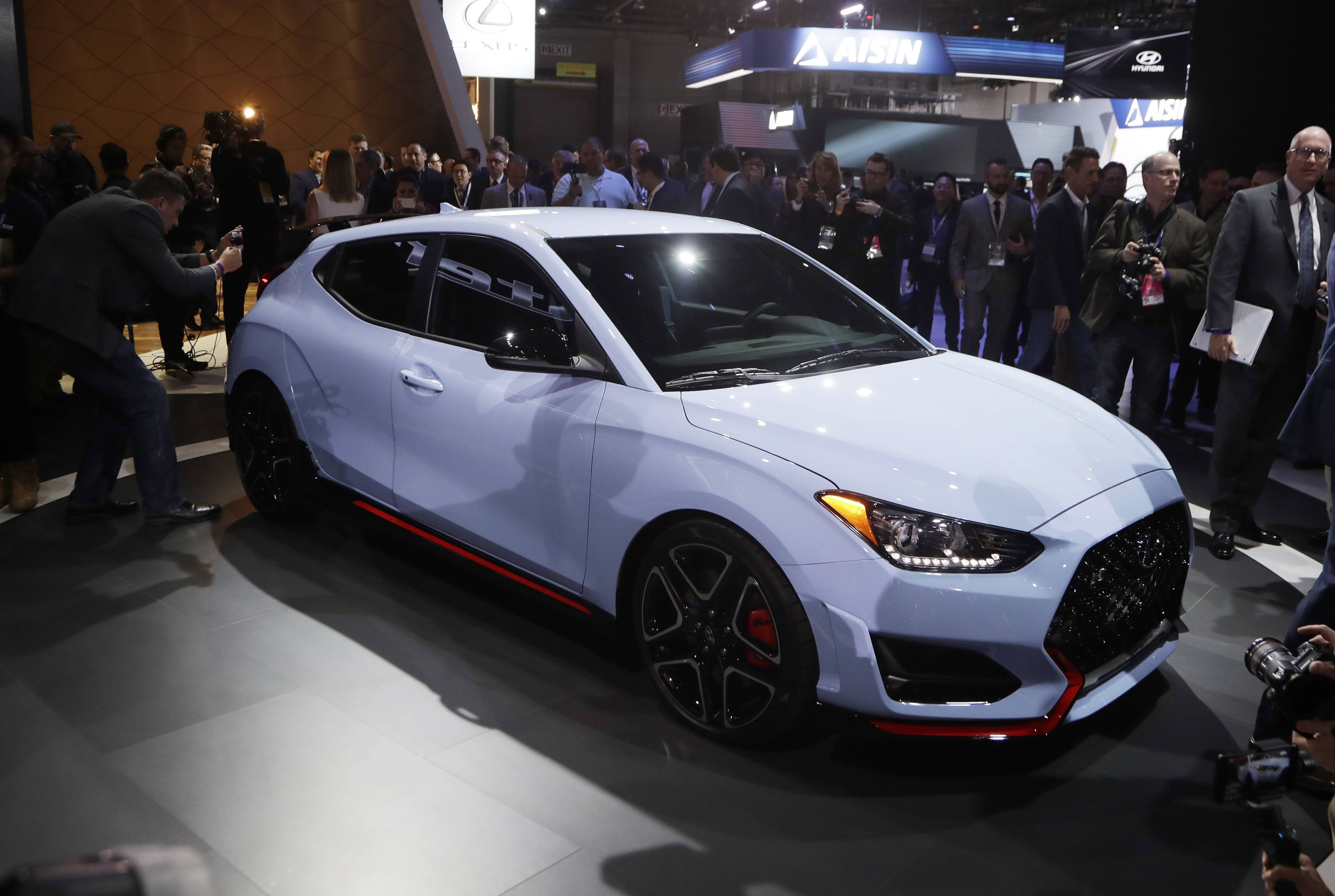Journalists look over the 2019 Veloster N model during the North American International Auto Show.
