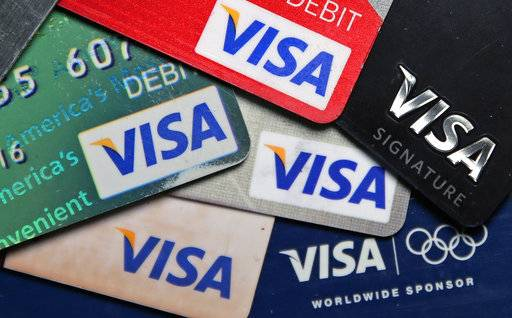 FILE - This Wednesday, June 4, 2014, file photo shows a selection of Visa cards in Boston. Visa Inc. reports earnings, Thursday, Feb. 1, 2018.