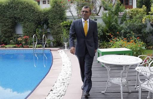 Former Maldives President Mohamed Nasheed poses for a photo following an interview with Associated Press in Colombo, Sri Lanka, Friday, Feb. 2, 2018.  The Maldives' Supreme Court ordered the release of imprisoned politicians, including exiled ex-President Mohamed Nasheed, saying their guilty verdicts had been politically influenced.
