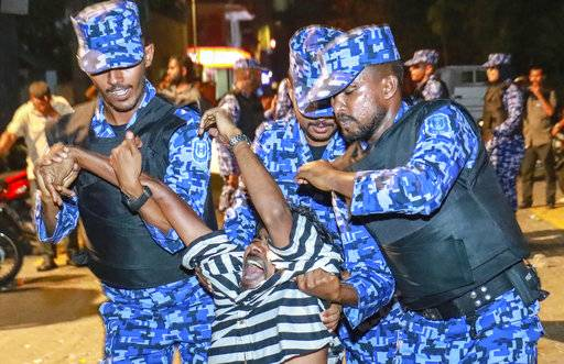 Maldivian police officers detain an opposition protestor demanding the release of political prisoners during a protest in Male, Maldives, Friday, Feb. 2, 2018. Opponents of the Maldives government clashed with police on the streets of the capital Friday as they demanded the release of imprisoned politicians whose convictions were overturned by the Supreme Court.